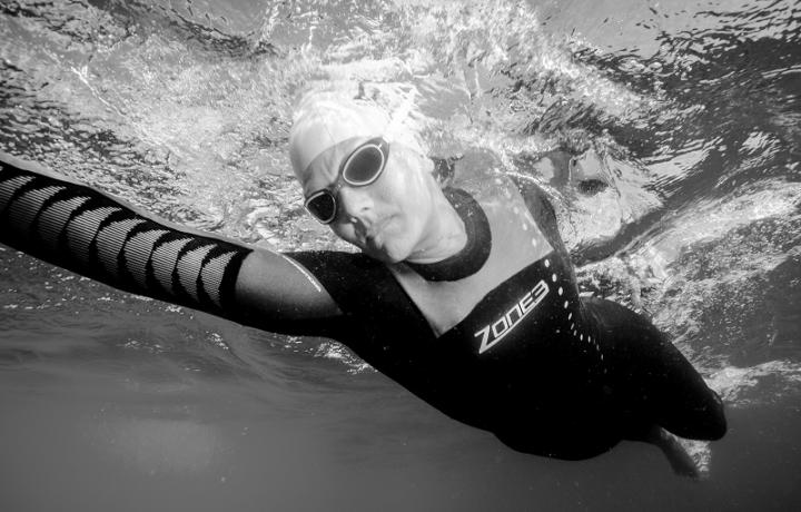 Black and White underwater photo of a swimmer in action