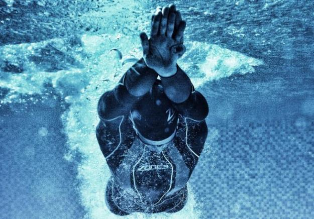 Underwater photo of a swimmer after kicking off from the pool wall in Zone3 kit