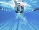 Woman powers through the water in deep pool