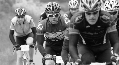 Black and White photo of cyclists in action